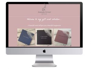 The Amanda Ferrari Gift Cards website in a laptop vector, that Squiggles Graphics - a website & graphics design agency in Langport, Somerset proudly created.