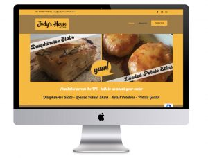 Image of Judy's House Foods website in a laptop vector, that Squiggles Graphics - a website & graphics design agency in Langport, Somerset proudly created.